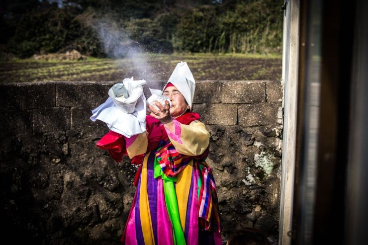 A shaman performs a ritual on Jeju Island. / Courtesy of Joey Rositano