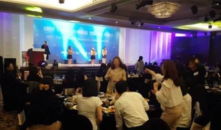 Students of the School of Performing Arts in Seoul (SOPA) perform on stage at a dinner party for an insurance company upon the principal's order. The photo was disclosed by Rep. Park Yong-jin of the Democratic Party of Korea at the National Assembly inspection of the Seoul Metropolitan Office of Education last October. / Yonhap