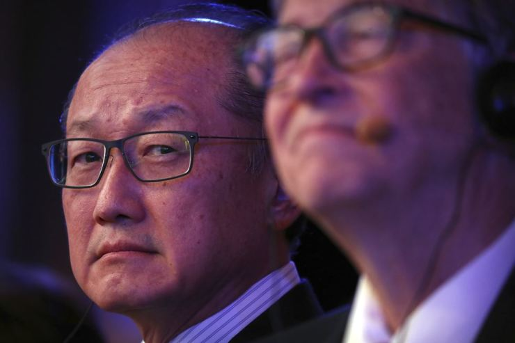 In this Nov. 6, 2018, file photo World Bank President Jim Yong Kim, left, and Bill Gates, former Microsoft CEO and co-founder of the Bill and Melinda Gates Foundation, listen to a speaker at the Reinvented Toilet Expo in Beijing. AP-Yonhap