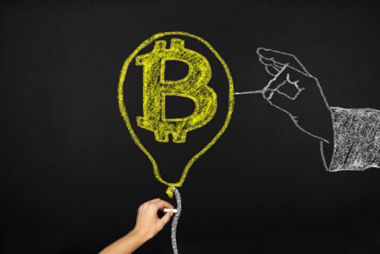 Some investors believe that bitcoin and other cryptocurrencies are still overvalued. gettyimagesbank