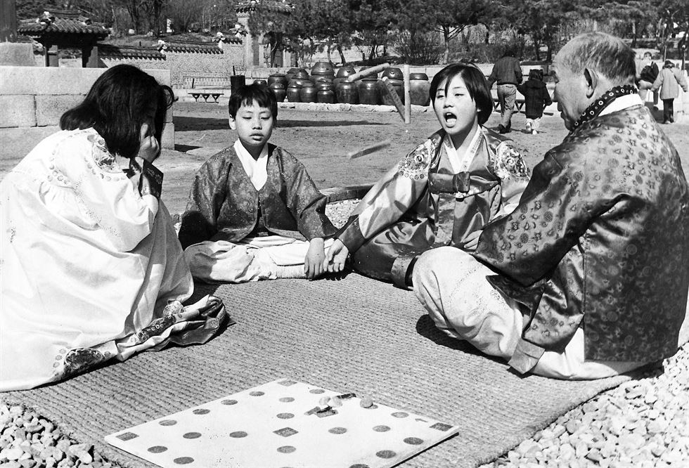 In this photo taken on Feb. 14, 1964, a woman makes a deep bow while the other speaks on the frozen surface of Seoul's Han River. It was the eve of the Lunar New Year's Day and they did this to 'console the spirits of their family members drowned in the river,' the attached caption read.