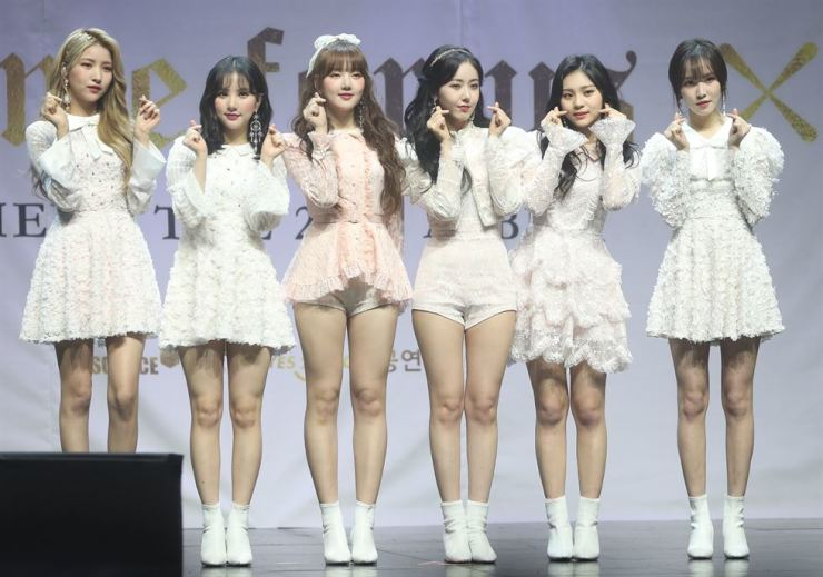 GFriend members pose for a photo at a press showcase promoting their second full-length album 'Time for Us' held in Seoul, Monday. Yonhap