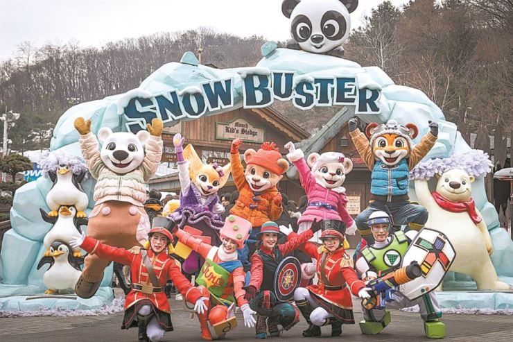 Characters from Everland pose in front of the theme park's snow sled course in Yongin, Gyeonggi Province. Everland stages a variety of performances such as a firework show, dance events and musicals during winter. / Courtesy of Everland