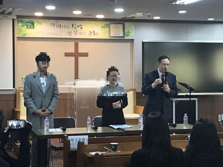 Rev. Shin Hyeon-uk of Guri Chodae Church, right, and two former members of SCJ speak during a press conference held in Guri, Gyeonggi Province, Tuesday. Courtesy of Guri Cult Counseling Center