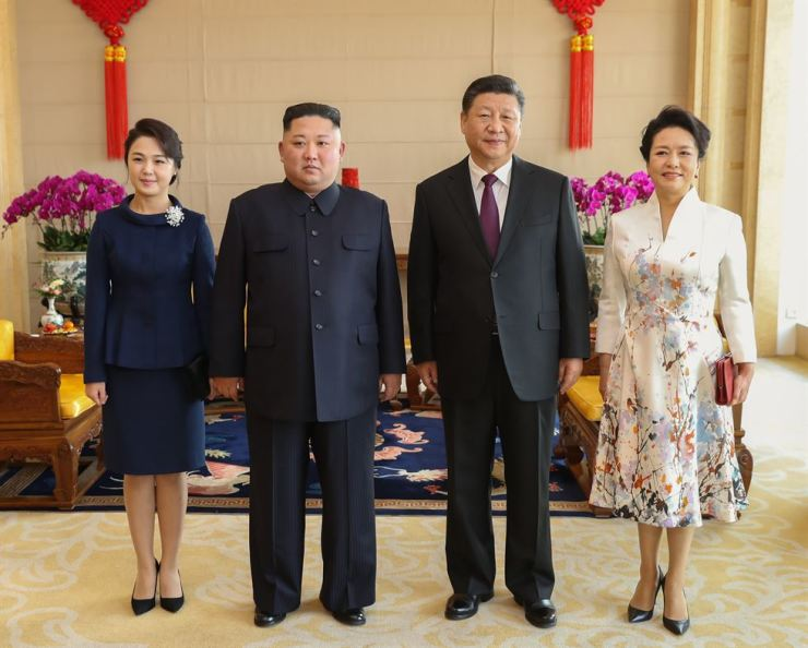 Xi Jinping (2nd R), general secretary of the Central Committee of the Communist Party of China and Chinese president, and his wife Peng Liyuan (1st R) pose for photos with Kim Jong Un (2nd L), chairman of the Workers' Party of Korea and chairman of the State Affairs Commission of the Democratic People's Republic of Korea, and his wife Ri Sol Ju at Beijing Hotel in Beijing, capital of China, Jan. 9, 2019. Xinhua-Yonhap