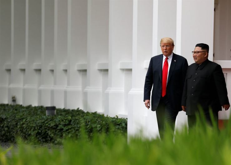 U.S. President Donald Trump and North Korean leader Kim Jong-un go for a walk after lunch at the Capella Hotel on the Singaporean island of Sentosa, last June 12. REUTERS