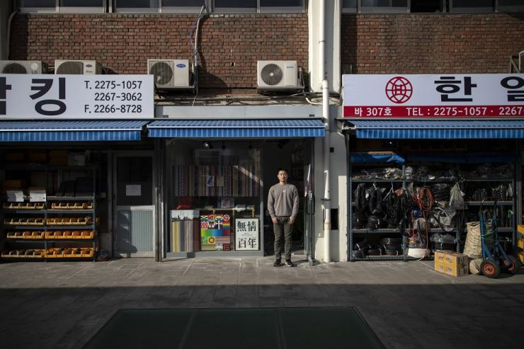 Lee Kyung-min, 32, stands outside his graphic design studio at Sewoon Electronics Plaza, Monday.  Korea Times photo by Shim Hyun-chul