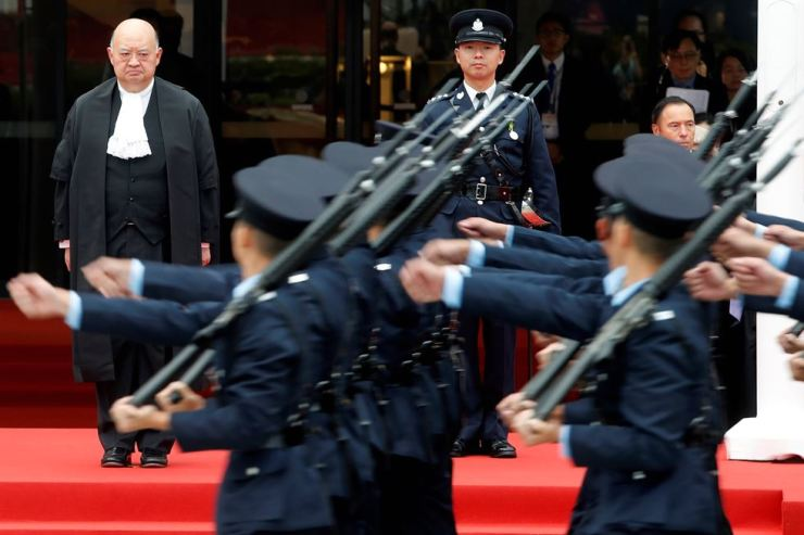 Police officers march past Hong Kong Chief Justice Geoffrey Ma Tao-li who attends a ceremony to mark the beginning of the legal year in Hong Kong, China January 14, 2019. REUTERS-Yonhap