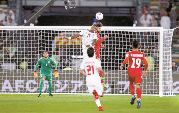 Ismail Al Hammadi ,left, of UAE in action against Waleed Al Hayam of Bahrain during the 2019 AFC Asian Cup group A preliminary round match between UAE and Bahrain in Abu Dhabi, United Arab Emirates, Saturday. EPA-Yonhap