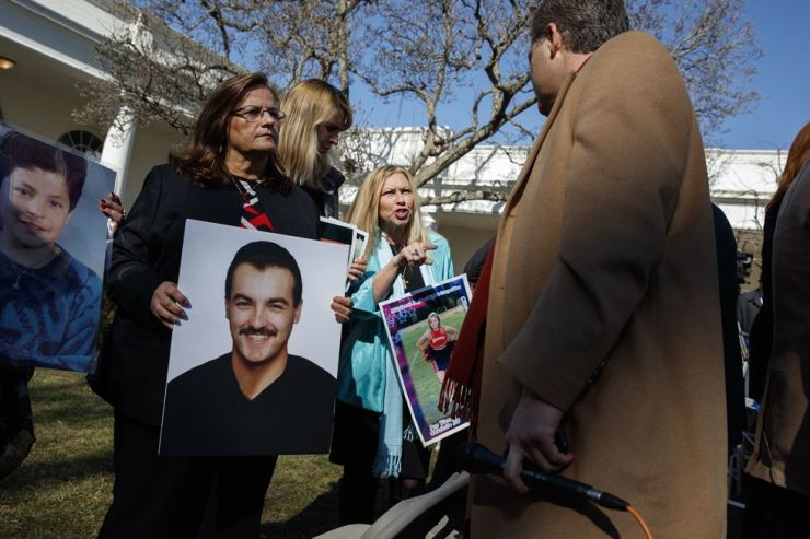 Family members who lost loved ones to violence from undocumented immigrants talk with CNN journalist Jim Acosta in the Rose Garden at the White House after U.S. President Donald Trump declared a national emergency in order to fund the building of a wall along the southern border with Mexico, Feb. 15. AP