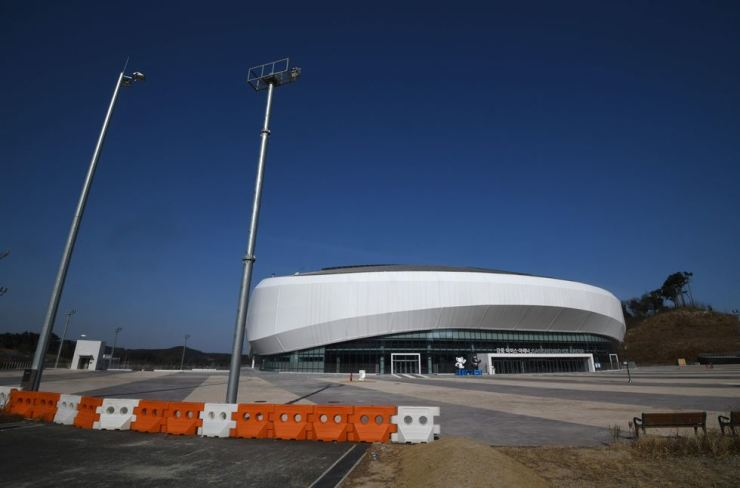 This picture taken on Jan, 24, shows the Gangneung Ice Arena, where the figure skating and short track speed skating were held during the PyeongChang 2018 Winter Olympic Games. - Just one year after the world's best skiers and skaters gathered in South Korea to compete for Olympic gold, many of the venues stand empty, with arguments mounting over their future and upkeep costs. AFP-Yonhap