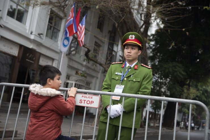 A Vietnamese policeman patrols near the Hanoi Metropole Hotel, a location thought to be the venue for the second United States-North Korea summit, Feb. 27. Korea Times photo by Choi Won-suk