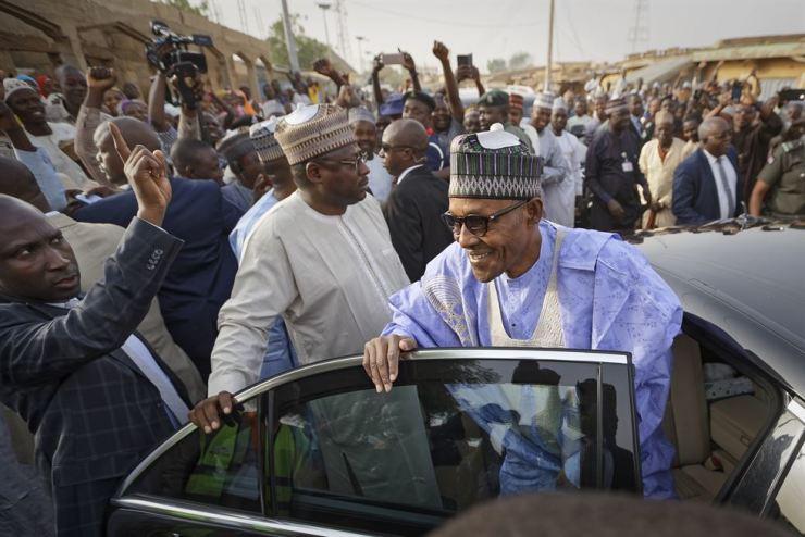 In this Feb. 23, 2019 file photo, Nigeria's President Muhammadu Buhari leaves after casting his vote in his hometown of Daura, in northern Nigeria. AP