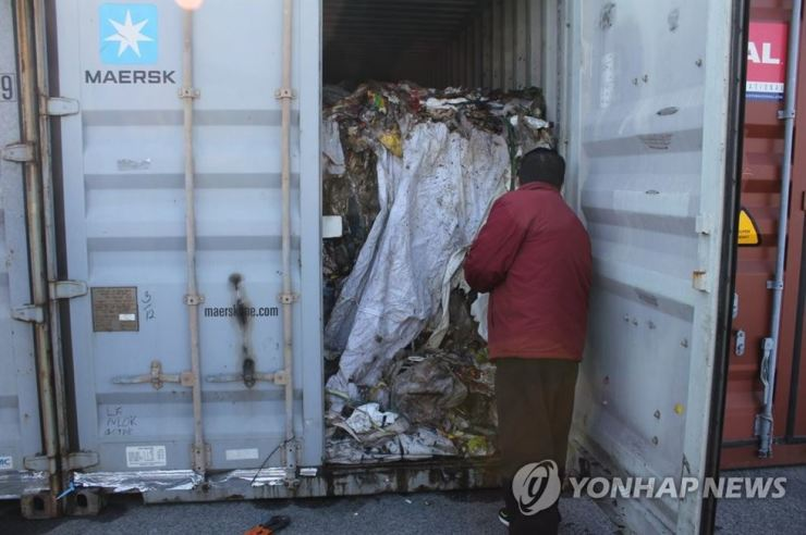 This photo, provided by the Ministry of Environment on Feb. 7, 2019, shows a container loaded with plastic waste that was brought back to South Korea after being illegally shipped to the Philippines last year. Yonhap