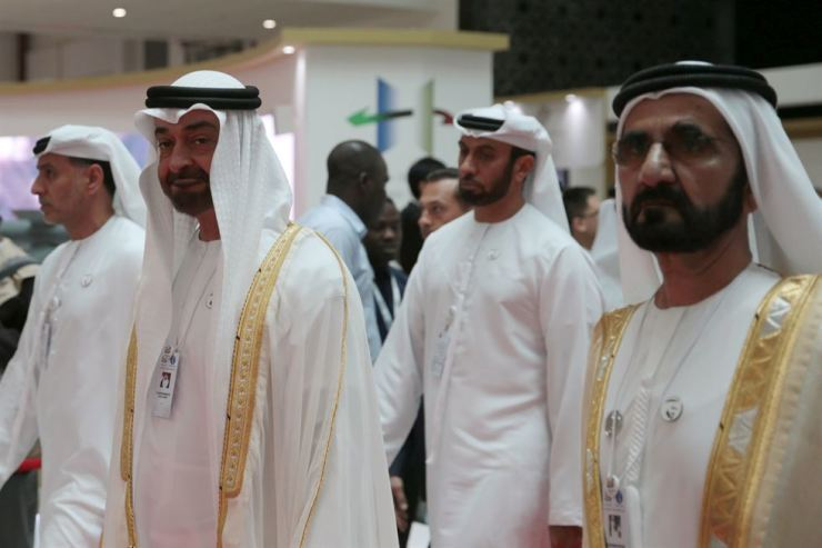 Abu Dhabi's Crown Prince Mohammed bin Zayed Al-Nahyan (2nd L) and Dubai's Ruler Sheikh Mohammed bin Rashid al-Maktoum, Prime Minister and Vice-President of the United Arab Emirates (R) attend the International Defence Exhibition & Conference in Abu Dhabi, United Arab Emirates Feb. 17. Reuters