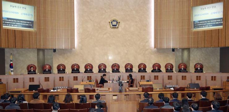 The 13-judge bench of the Supreme Court in Seocho-gu, Seoul, Thursday. Yonhap