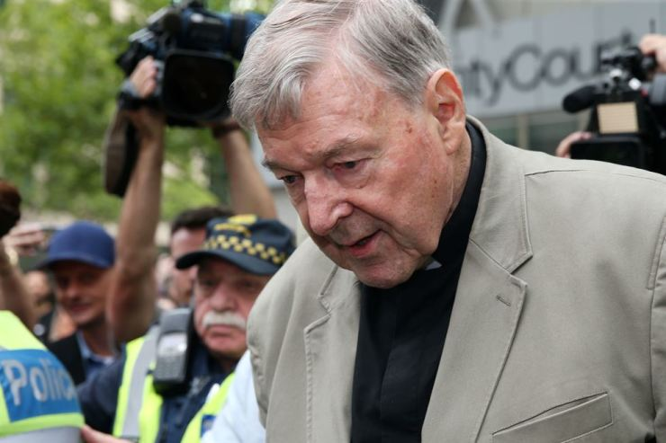 Cardinal George Pell leaves the County Court of Victoria in Melbourne, Australia, Tuesday after prosecutors decided not to proceed with a second trial on alleged historical child sexual offences. AFP-Yonhap