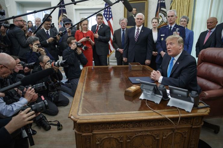US President Donald J. Trump (R) participates in a signing ceremony for Space Policy Directive 4 in the Oval Office of the White House in Washington, DC, USA, 19 February 2019. EPA