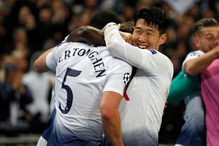 Tottenham Hotspur's Belgian defender Jan Vertonghen, left, celebrates with Tottenham Hotspur's South Korean striker Son Heung-Min, right, after scoring their second goal during the UEFA Champions League round of 16 first leg football match between Tottenh