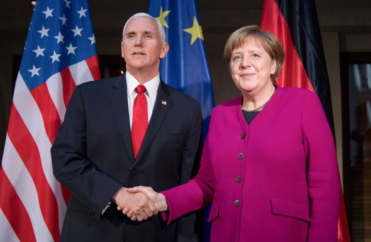 German Chancellor Angela Merkel (R) and US Vice President Mike Pence shake hands at a photo call during the 55th Munich Security Conference (MSC) in Munich, southern Germany, on February 16, 2019. AFP