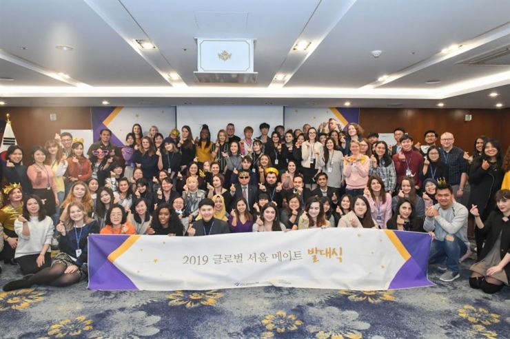 Members of the Global Seoul Mates pose during a launching ceremony at the Seoul Tourism Organization, Feb. 22. / Courtesy of Seoul Tourism Organization