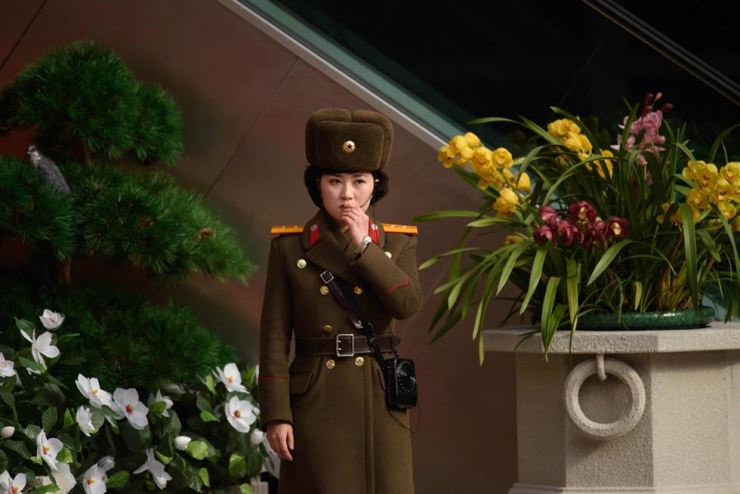 A Korean People's Army soldier stands at the entrance to a 'Kimjongilia' flower exhibition celebrating late North Korean leader Kim Jong-il in Pyongyang on Feb. 14. AFP