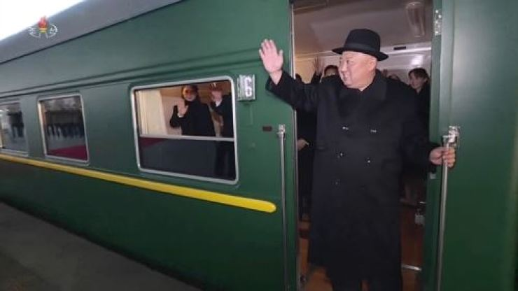 Video footage from North Korea's state-run Korean Central Television (KCTV) shows North Korean leader Kim Jong Un waving from a train as it leaves Pyongyang, Jan. 7, to head to Beijing for a fourth North Korea-China summit. KCTV-Yonhap