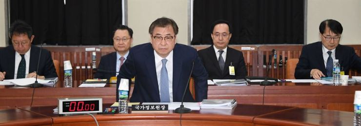 National Intelligence Service Director Suh Hoon, center, participates in a meeting of the National Assembly's intelligence committee to brief about the spy agency's activities and North Korea, Friday. Korea Times photo by Oh Dae-geun