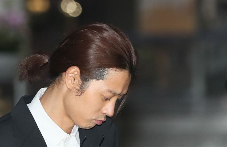 Singer Jung Joon-young exits the Seoul Metropolitan Police Agency after being questioned over sexual misconduct allegations on Friday. Yonhap