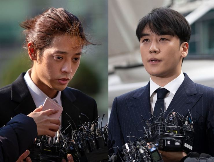 Jung Joon-young, left, and Seungri appear at the Seoul Metropolitan Police Agency for questioning,Thursday. / Korea Times photo by Shim Hyun-chul, Choi Won-suk