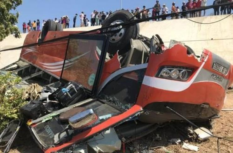 A tourist bus is overturned after an accident in Phan Thiet, Vietnam, Saturday. Yonhap