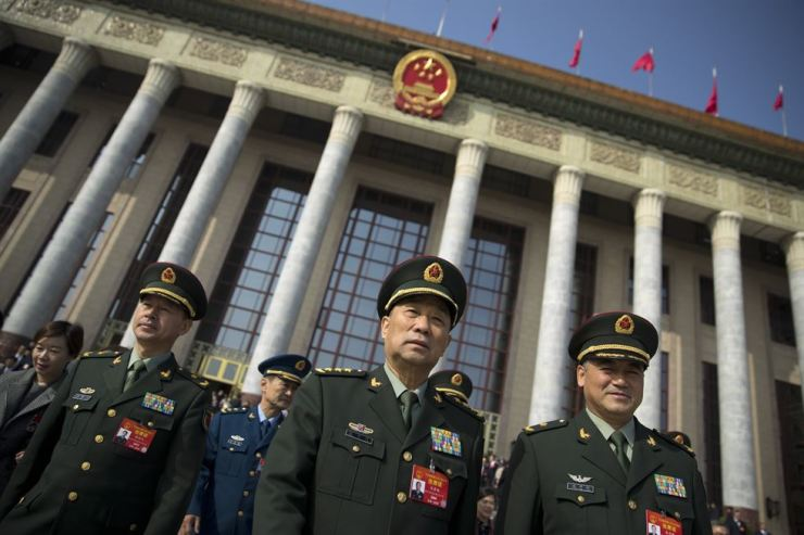 In this March 4 photo, military delegates leave after a meeting the day before the opening session of China's National People's Congress at the Great Hall of the People in Beijing. To a remarkable degree, the Pentagon's new budget proposal is shaped by national security threats that Acting Defense Secretary Patrick Shanahan has summarized in three words: 'China, China, China.' AP