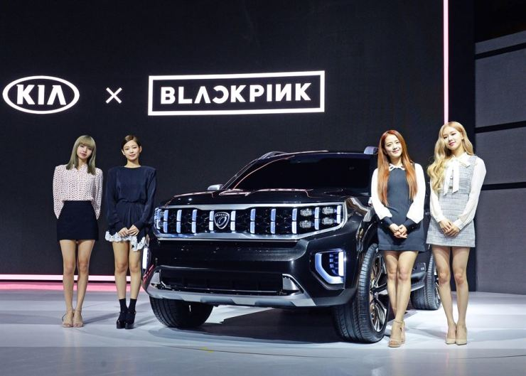 Members of K-pop group BLACKPINK pose with Kia Motors' Mohave Masterpiece concept during the brand's press conference at the Seoul Motor Show in Goyang, Gyeonggi Province, Thursday. Courtesy of Kia Motors