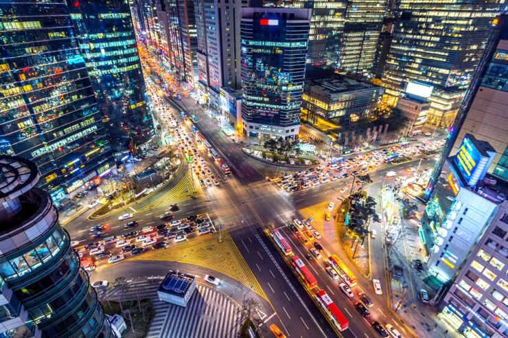 Traffic speeds through an intersection at night in southern Seoul. GETTYIMAGESBANK