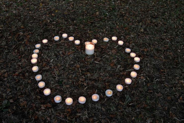 Candles lay in a heart shape across the road from the Masjid Al Noor mosque on March 19, 2019 in Christchurch, New Zealand, where worshipers were gunned down three days ago. New Zealand will tighten gun laws in the wake of its worst modern-day massacre, the government said, as it emerged that the white supremacist accused of carrying out the killings at two mosques will represent himself in court. AFP