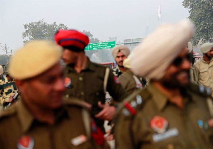 Police stand guard before the arrival of an Indian Air Force pilot, who was captured by Pakistan on Wednesday, near Wagah border, on the outskirts of the northern city of Amritsar, India, March 1. Reuters