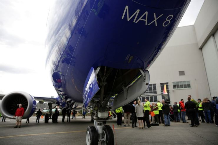Boeing employees in front of a 737 MAX 8 produced for Southwest Airlines as Boeing celebrates the 10,000th 737 to come off the production line in Renton, Washington, on March 13, 2018. Reuters