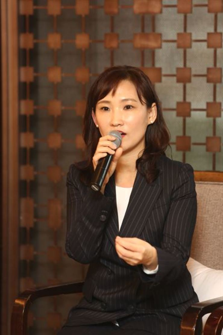 Justine Lim, Booking.com's North Asia regional manager, speaks during a press conference in Seoul, March 12. / Courtesy of Booking.com