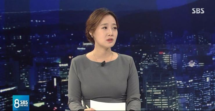 Reporter Kang Kyung-yoon, who broke the story about Jung Joon-young's sex video scandal, speaks about Seungri and others involved during Wednesday's SBS primetime news program. Screen capture from SBS News