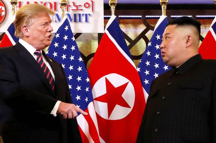 U.S. President Donald Trump speaks to North Korean leader Kim Jong-un after shaking hands before their second summit at the Metropole Hotel in Hanoi, Vietnam Feb. 27. Reuters-Yonhap