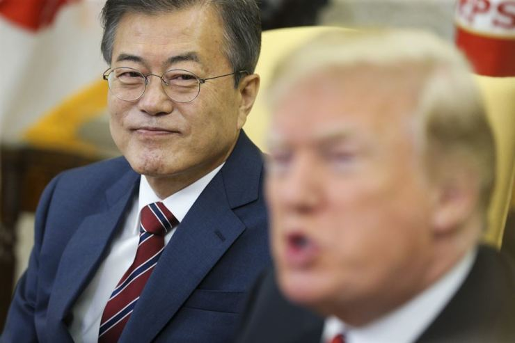 President Moon Jae-in, left, listens to U.S. President Donald Trump during a meeting in the Oval Office of the White House in Washington, DC, the U.S., May 22, 2018. EPA