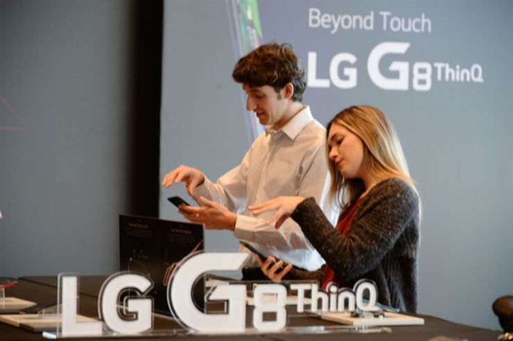 Visitors try LG G8 ThinQ during the unveiling event in Barcelona on Feb. 24. / Courtesy of LG Electronics