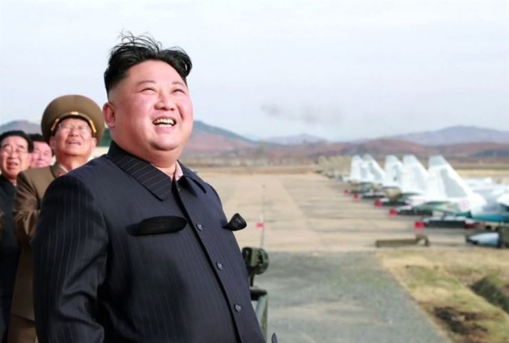 North Korean leader Kim Jong-un smiles while overseeing an air force exercise byUnit 1017 of the Air and Anti-Aircraft Force of the Korean People's Army, Tuesday. Yonhap