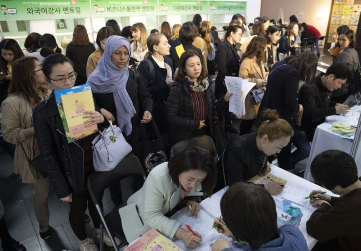Foreign wives attend a job fair held at Seoul City Hall on April 5. / Yonhap