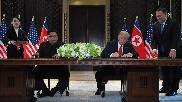In this file photo taken last June 12, U.S. President Donald Trump and North Korean leader Kim Jong-un sign documents as U.S Secretary of State Mike Pompeo and the North Korean leader's sister Kim Yo-jong look on at the Capella Hotel on Sentosa Island in Singapore. AP-Yonhap