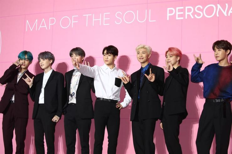 Members of BTS ham it up during Wednesday's press conference at DDP. Yonhap