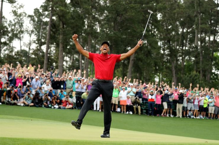 Tiger Woods of the U.S. celebrates on the 18th hole after winning the 2019 Masters. REUTERS