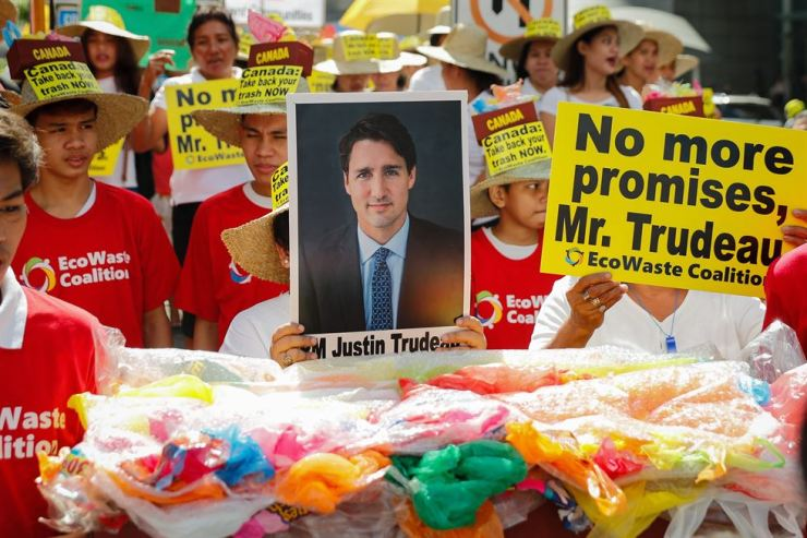Demonstrators hold placards and an image of Canadian Prime Minister Justin Trudeau during a protest at the Canadian Embassy in Makati, south of Manila, April 29. The protest led by the Ecowaste Coalition group demanded the return of Canada's overstaying waste in the country one week after Philippine President Rodrigo Duterte issued an ultimatum to the Canadian government. EPA