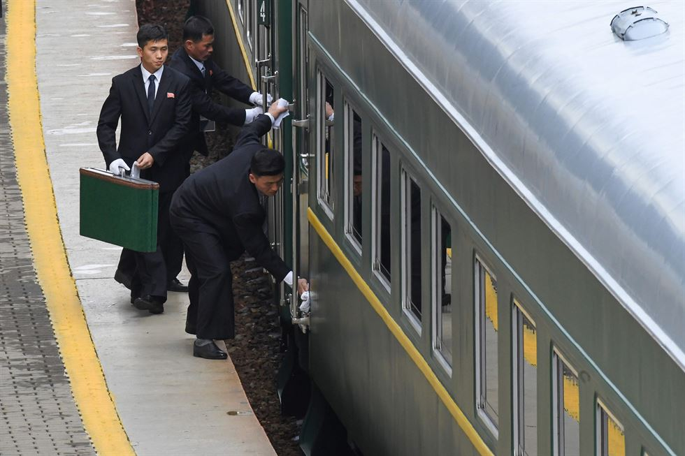 North Korean leader Kim Jong-un gets out of his car for a ceremony upon his departure from Russia, outside the railway station in the far-eastern Russian port of Vladivostok, April 26. AFP-Yonhap