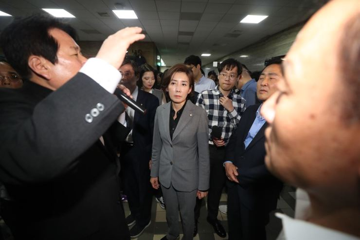 Rep. Na Kyung-won, center, floor leader of the main opposition Liberty Korea Party, gets disappointed after listening to the fact that four other political parties have submitted controversial reform bills which her party has been opposing for at the National Assembly, Friday. / Yonhap